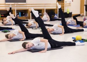 Students doing Pilates in a studio