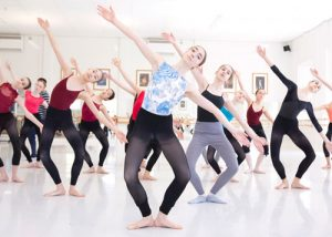 Studio full of students practicing a contemporary routine