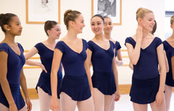 Ladies laughing and chatting at the end of a ballet class