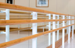 Abstract image of an empty barre in the studio.
