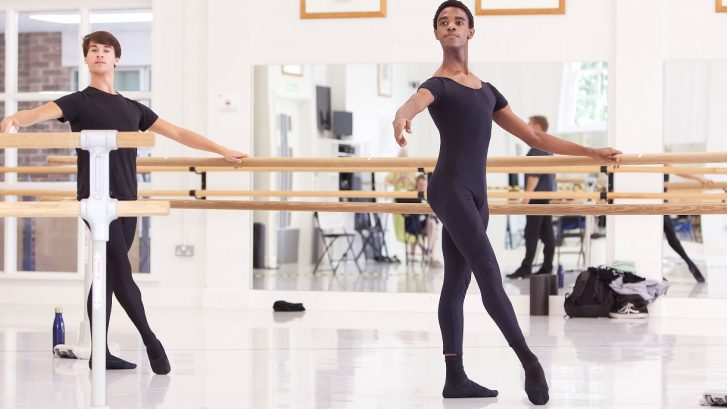 Two students dance in the studio as part of an Online Intensive course