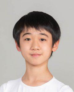 Headshot of International Scholar Rei Kida