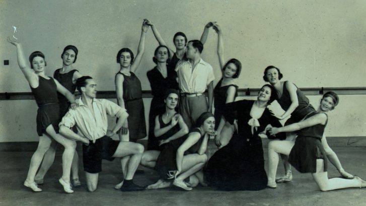 Ninette de Valois (standing centre) and Ursula Moreton (kneeling in dress) with students of the Vic-Wells School just after it became resident at Sadler's Wells Theatre in 1931.